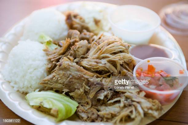 plate lunch at aloha mixed plate cafe.  includes kahlua pork, centre, lomi lomi salmon, right foreground, poi, centre right, haupia, rear right.  also macaroni salad and rice. - poi_(food) stock pictures, royalty-free photos & images