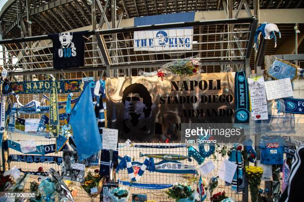 Plate naming unofficially the San Paolo stadium after the soccer player Diego Armando Maradona is seen among other tributes on the fences during the...