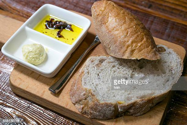 A Plate of Appetizer, Baguette with Cream, Oliver Oil and Balsamic Vinegar