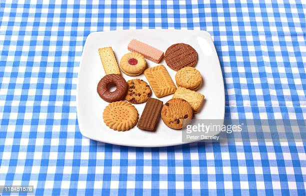Plate of assorted biscuits on table cloth