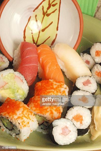a plate of assorted fresh sushi and rolls - pickled ginger stock pictures, royalty-free photos & images