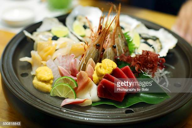 Plate of assorted traditional japanese sashimi