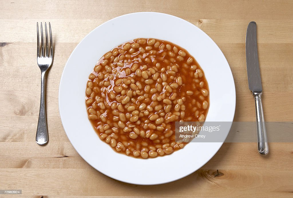 Plate of baked beans, overhead view : Stock Photo