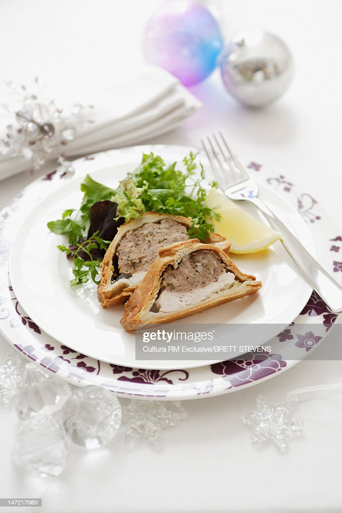 Plate of baked meat pie with salad  Stock Photo & Plate Of Baked Meat Pie With Salad Stock Photo | Getty Images