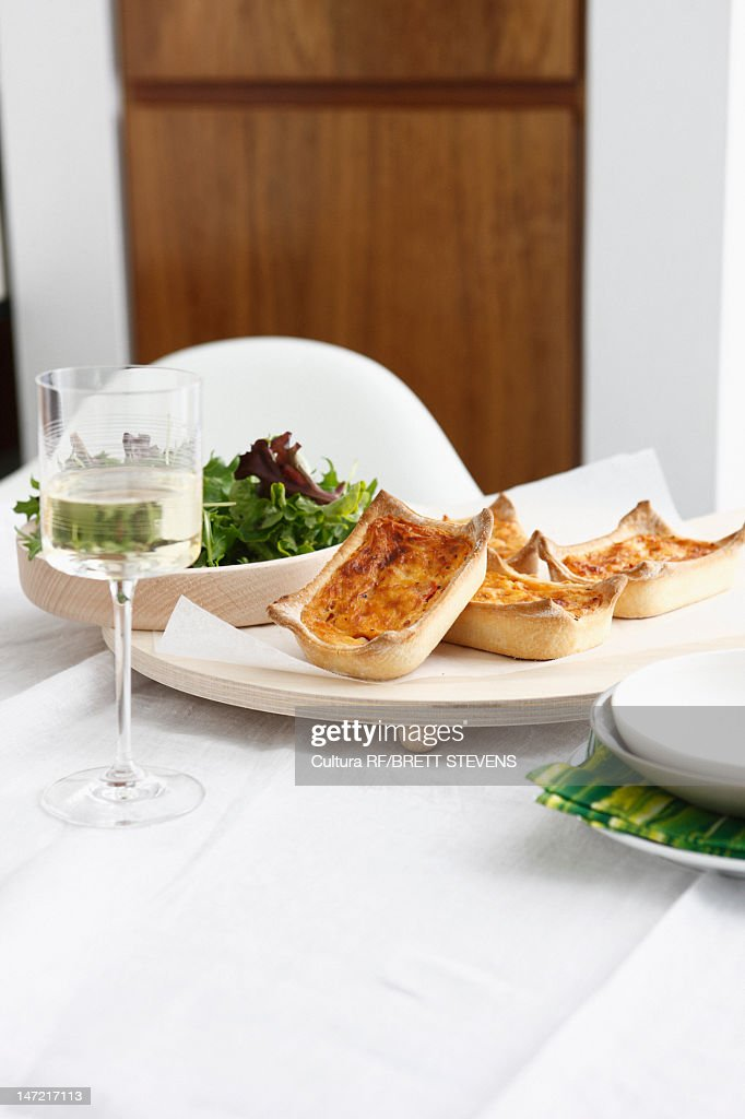 Plate of baked quiche cups with salad : Stock Photo