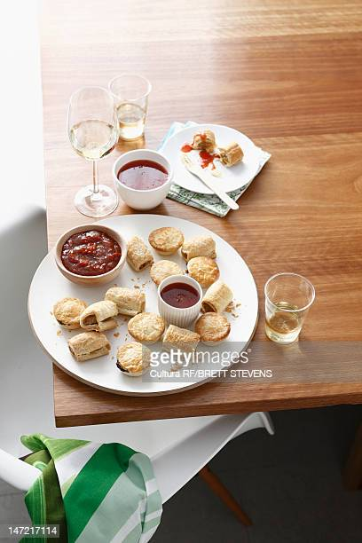 Plate of baked tarts with dipping sauce