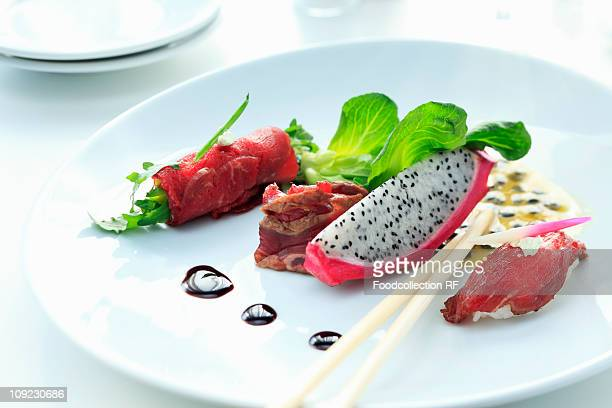 Plate of beef and pitaya appetisers