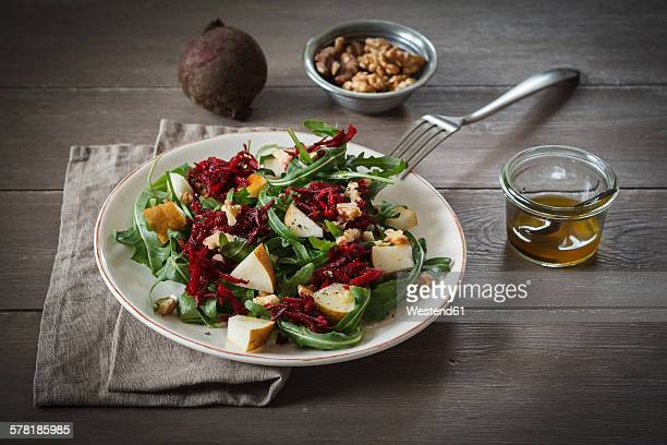 Plate of beetroot salad with rocket and walnuts