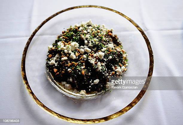 A plate of beluga lentils with carrots pinenuts and feta chees prepared by Lucques chef Suzanne Goin is on display during food and wine event at...