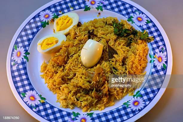 plate of biryani - biryani stock photos and pictures