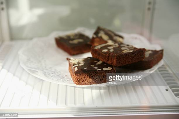 plate of brownies in refrigerator - doily ストックフォトと画像