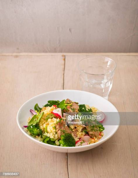 Plate of buckwheat salad with vegetables and diced Striploin Steak