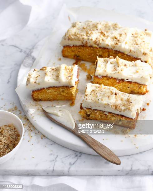 plate of carrot cake with frosting - carrot cake stock pictures, royalty-free photos & images
