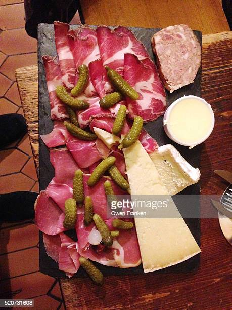 A plate of charcuterie - meats and cheese in a Paris pub