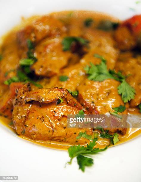 A plate of Chicken Tikka Masala is pictured in the Shish Mahal restaurant in Glasgow Scotland on July 29 2009 The Ali family owners of Shish Mahal...