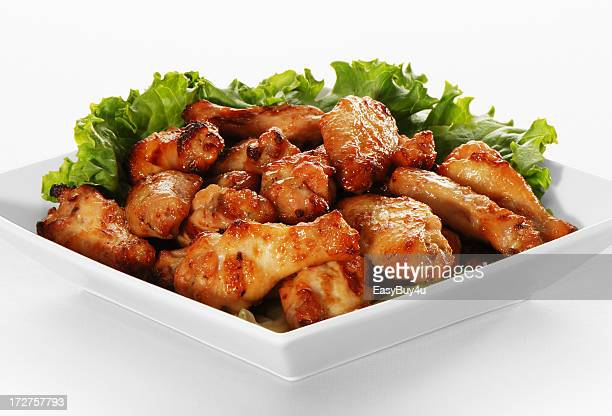 Plate of chicken wings with leaf garnish