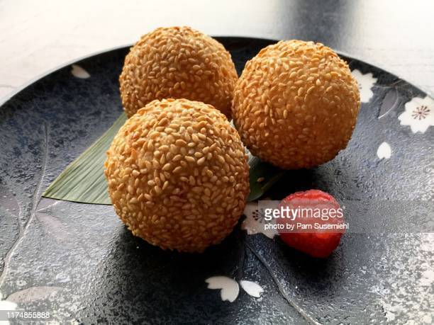 plate of chinese dessert sesame balls - sesame stock pictures, royalty-free photos & images