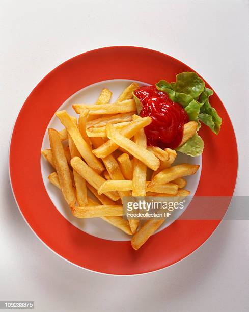 Plate of chips with ketchup, close-up