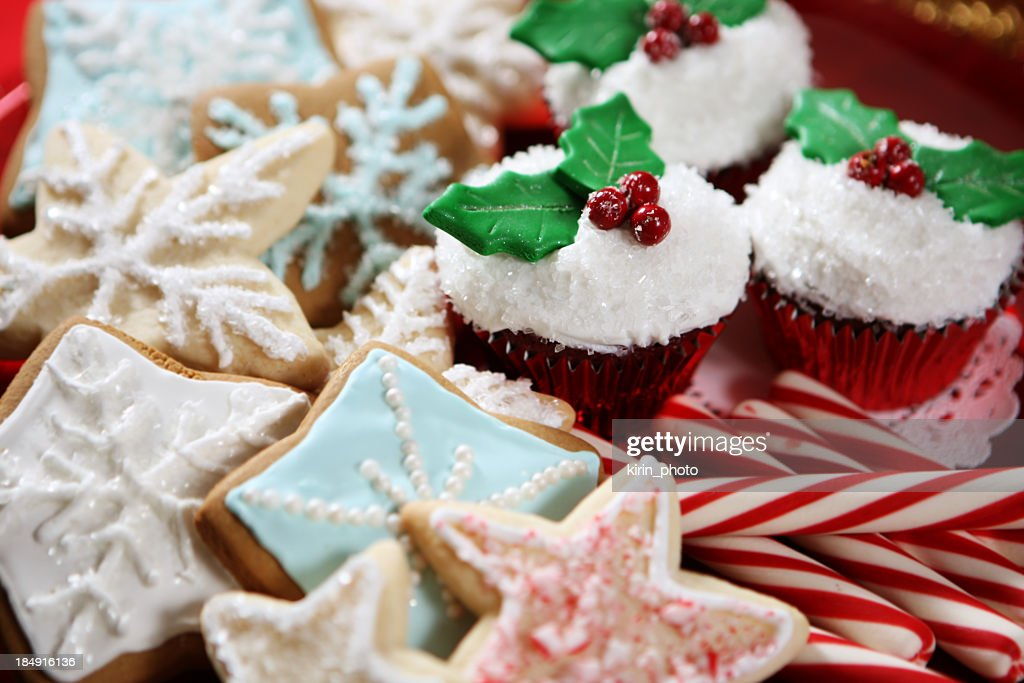 A plate of Christmas cookies, cupcakes and candy canes : Stock Photo