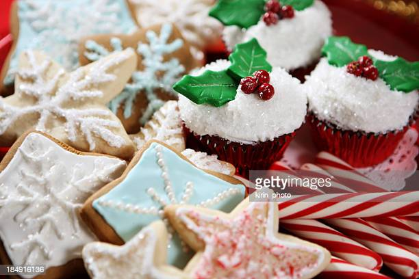 a plate of christmas cookies, cupcakes and candy canes - christmas cookies stock pictures, royalty-free photos & images