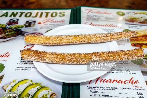 A plate of churros from La Casa de los Abuelos restaurant