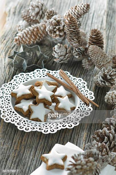 Plate of cinnamon stars and Christmas decoration
