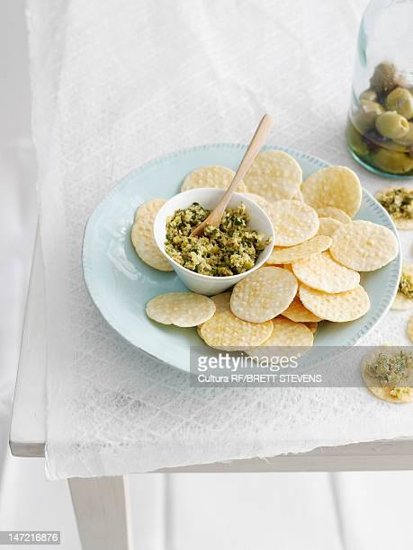 Plate of crackers with topping