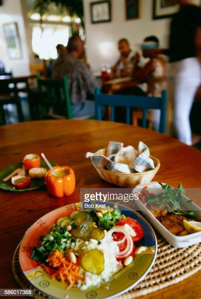 plate of creole food - port of spain stock pictures, royalty-free photos & images
