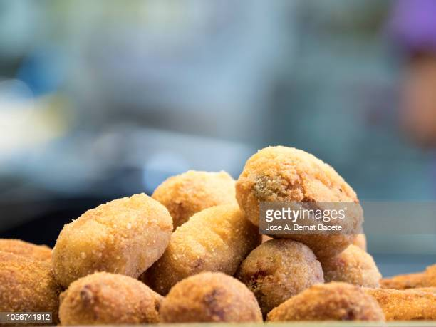 plate of croquettes on the bar of a bar to take as appetizer. - croquette stock photos and pictures