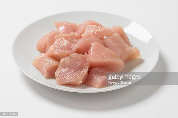 Plate of cubed chicken breasts