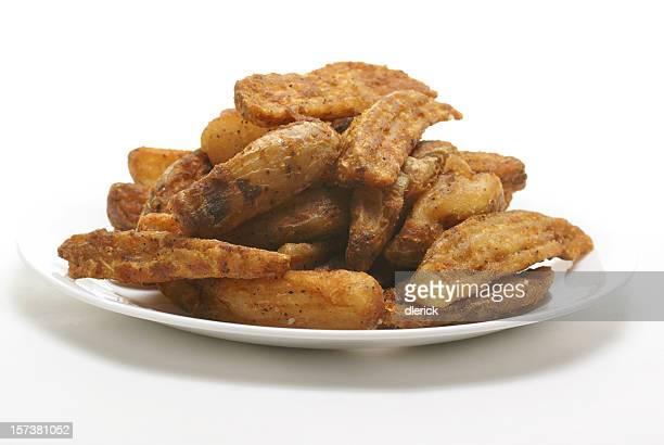 plate of deep fried potato wedges