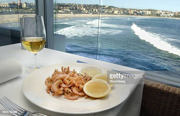 A plate of deepfried shrimp is arranged for a photograph at Icebergs Dining Room and Bar which is perched on the southern headland of Bondi Beach in...