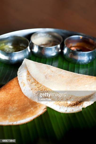 A plate of dosa a pancake of fermented rice and black lentils served alongside various chutneys at the Visalam Hotel in Kanadukathan village in...