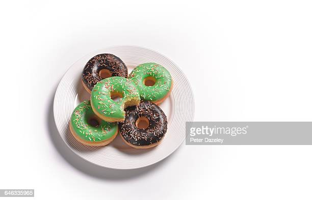 Plate of doughnuts with a bite out