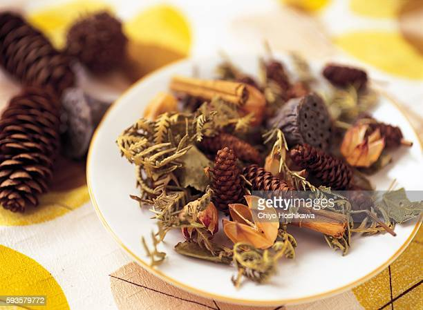 A Plate of Dried Flowers and Pine Cones
