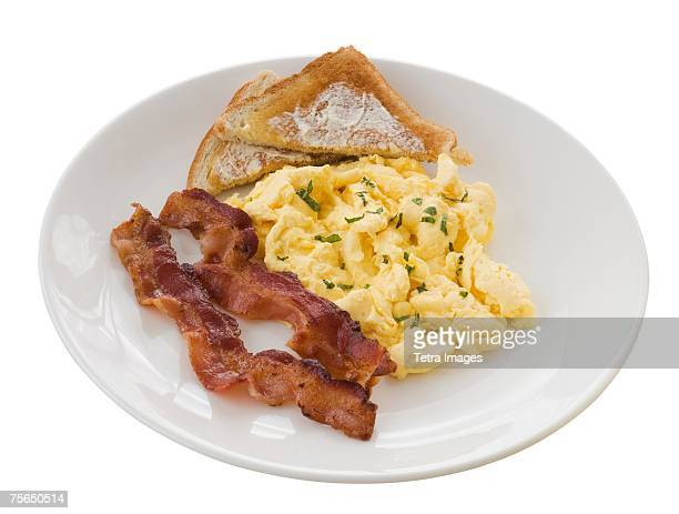 Plate of eggs, toast and bacon