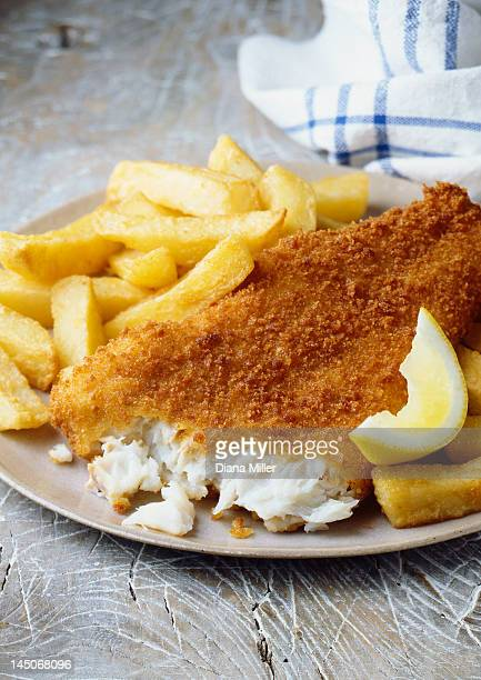 Plate of fish and chips with lemon