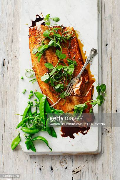 Plate of fish and snow peas