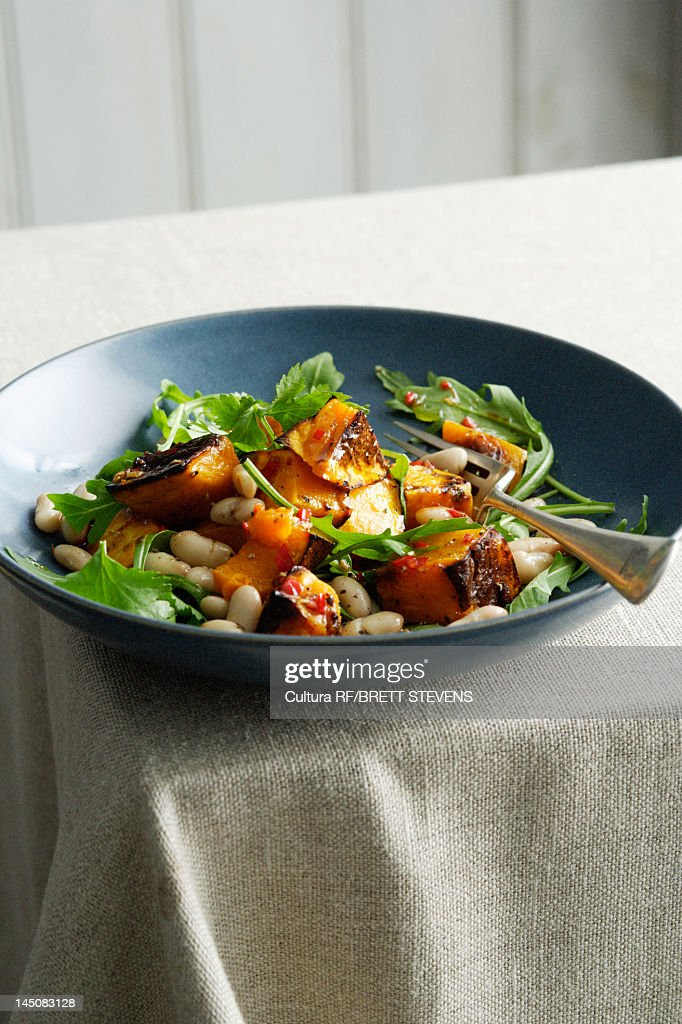 Plate of fish with beans : Stock Photo