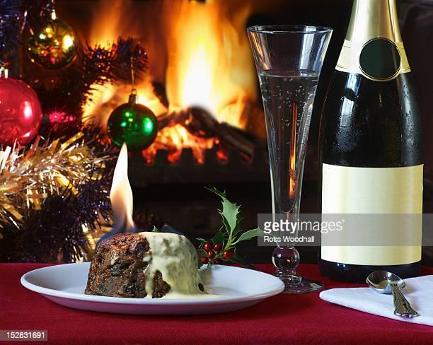 Plate of flaming Christmas pudding