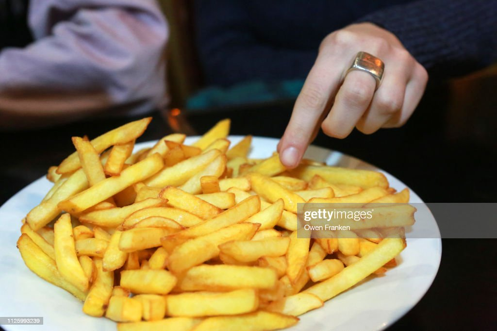 A plate of French fried potatoes in a Paris bistro : Stock Photo