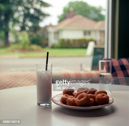 A plate of fresh donuts and a tasty drink