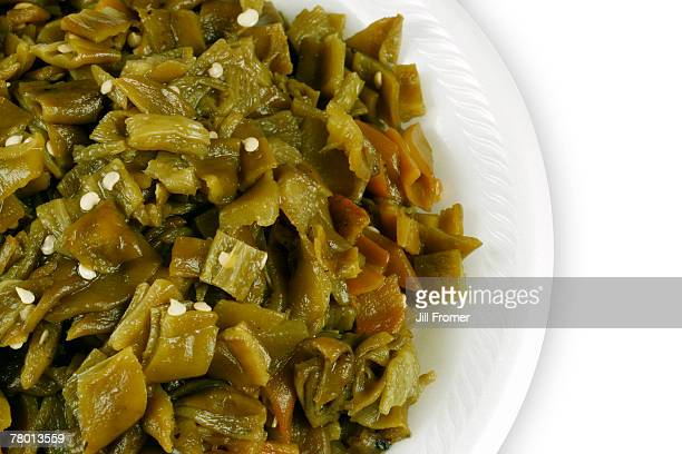 a plate of fresh hatch, new mexico green chile that has been roasted, peeled and chopped.  - green chili pepper stock pictures, royalty-free photos & images