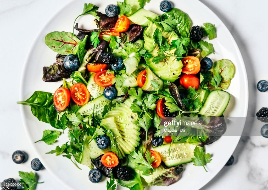 Plate of fresh salad on white background : Stock Photo