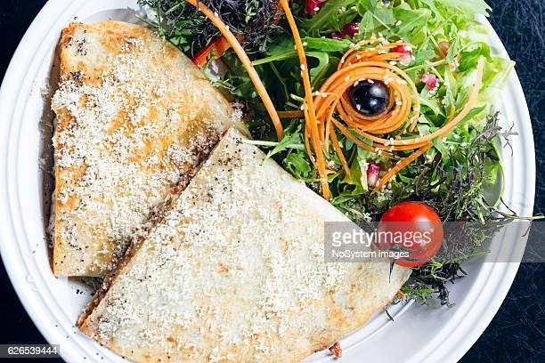 Plate of fried brown vegeterian potato pancakes