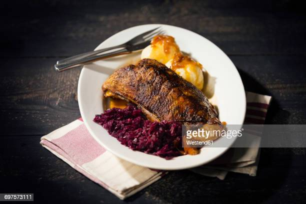 Plate of fried goose breast, red cabbage and potato dumplings