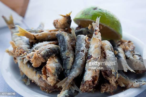 Plate of fried sardines at taverna