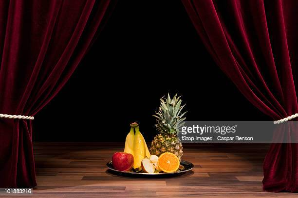 A Plate Of Fruit On A Theatre Stage