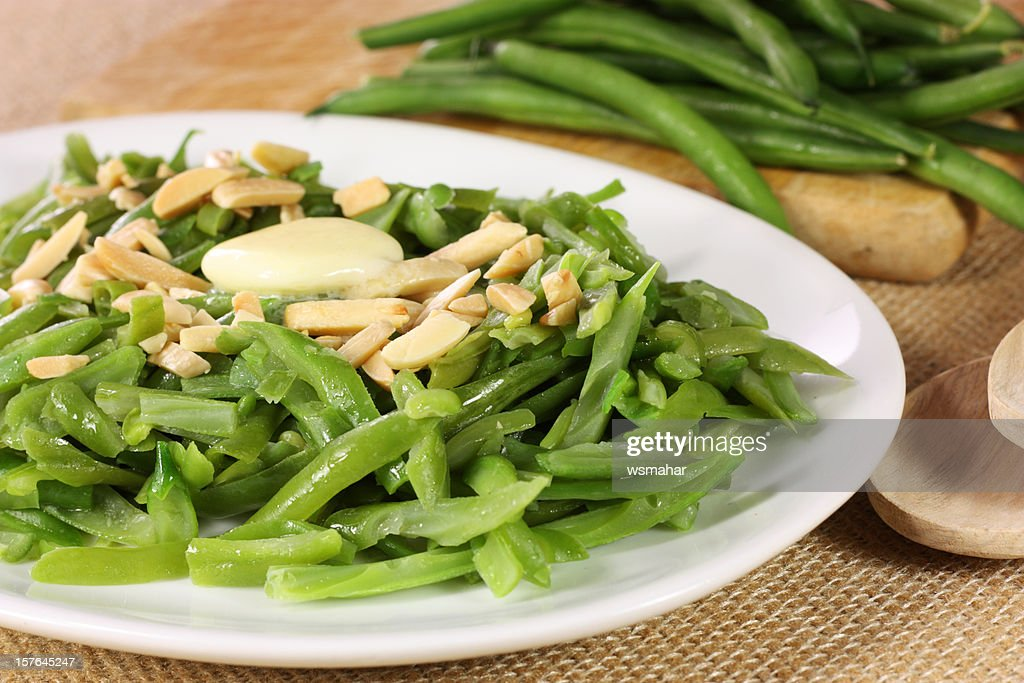 A plate of green beans and almonds : Stock Photo