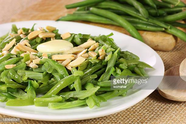 A plate of green beans and almonds